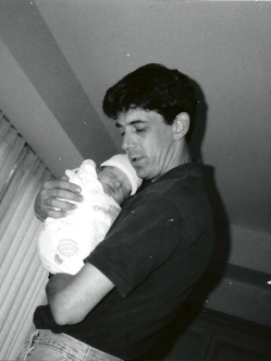 Black and white photo of dad holding baby Justin