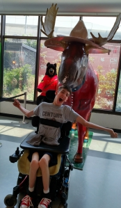 Justin in front of Moose statue