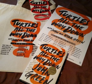 Turtles All the Way Down book, poster, bag and tour pamphlet