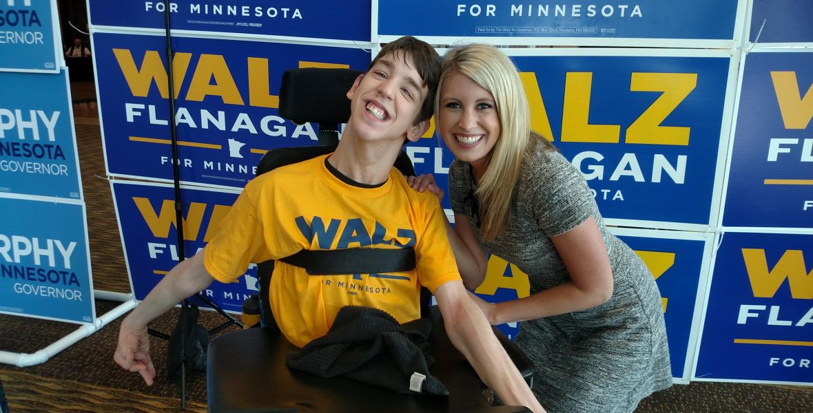 Justin with reporter Noelle Anderson smiling