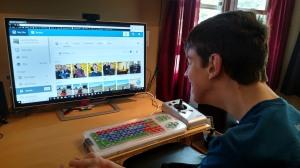 Justin looking at computer