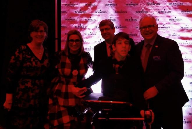 Justin, his parents, Lieutenant Governor Flanagan and Governor Walz