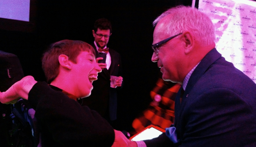 Justin smiling with MN Governor Walz