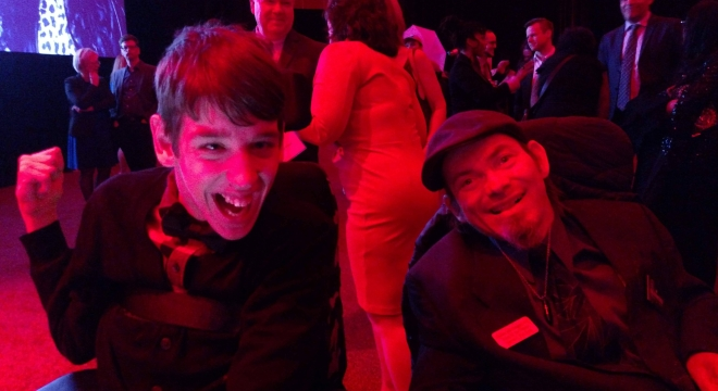 Justin and man using wheelchair at inaugural celebration