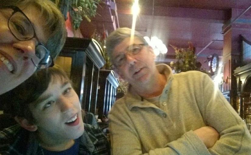 Mom, Justin and dad at a bar