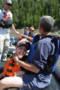 Justin and dad with group of people on float raft