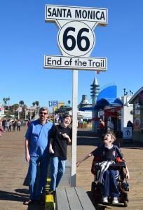Justin, dad and brother at Santa Monica End of the Trail sign