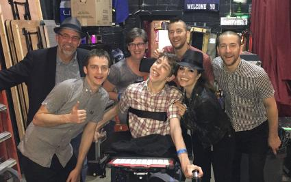 Justin, mom, dad with the Interrupters band