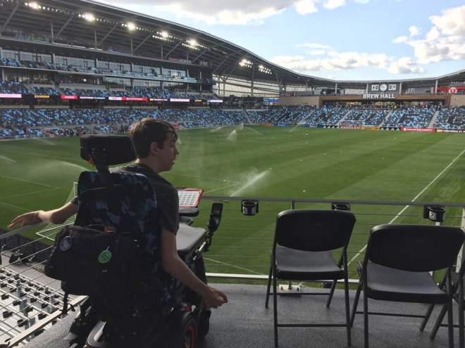 Justin in wheelchair looking at the field in Allianz Stadium