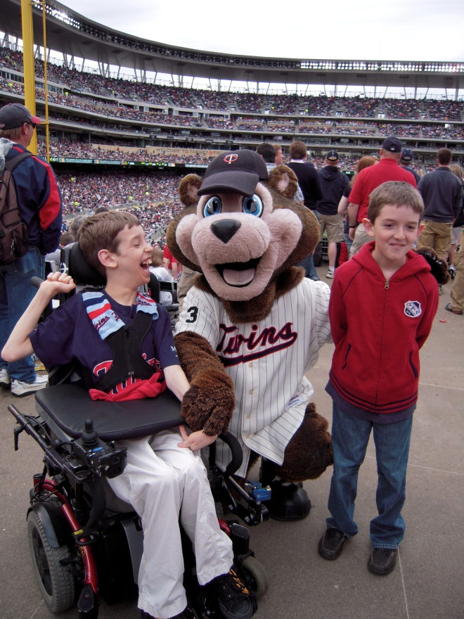12 year old Justin and his brother with the Twins mascot at Twins Stadium