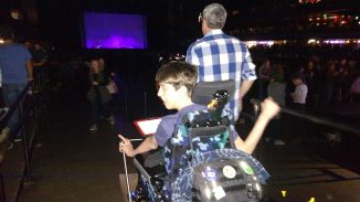 Justin in wheelchair in crowd