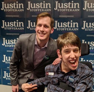 Justin Stofferahn and Justin Smith smiling