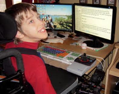 Justin smiling at computer