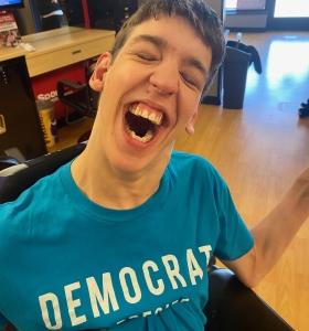 Smiling Justin wearing Democrat shirt