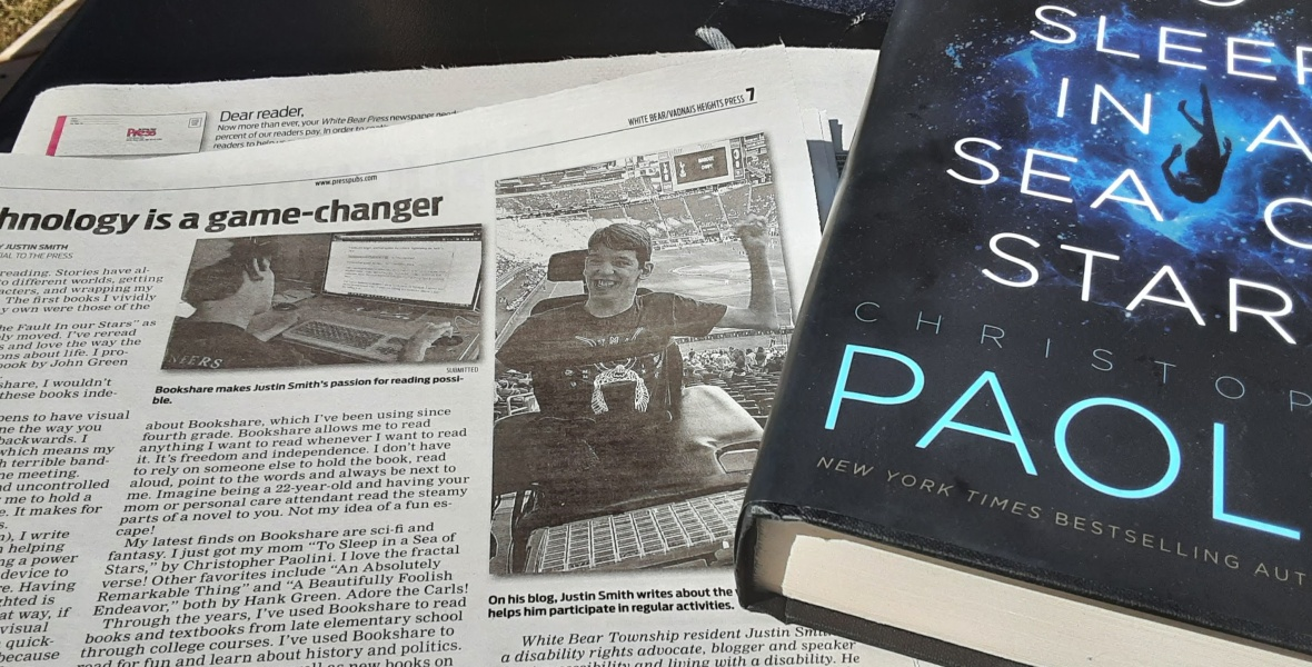 Newspaper open to Technology is a game-changer article, To Sleep in a Sea of Stars book by Christopher Paolini