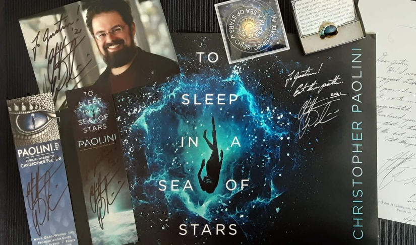 autographed To Sleep in a Sea of Stars poster, bookmarks, letter, photograph of Christopher Paolini