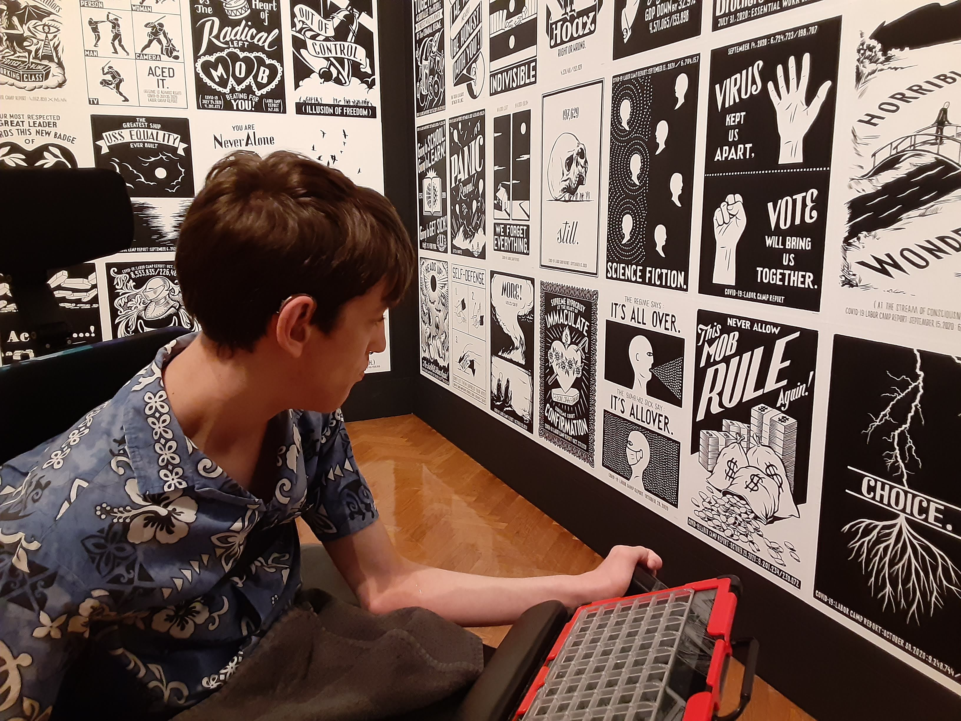Justin looking at Piotr Szyhalski art exhibit black and white prints