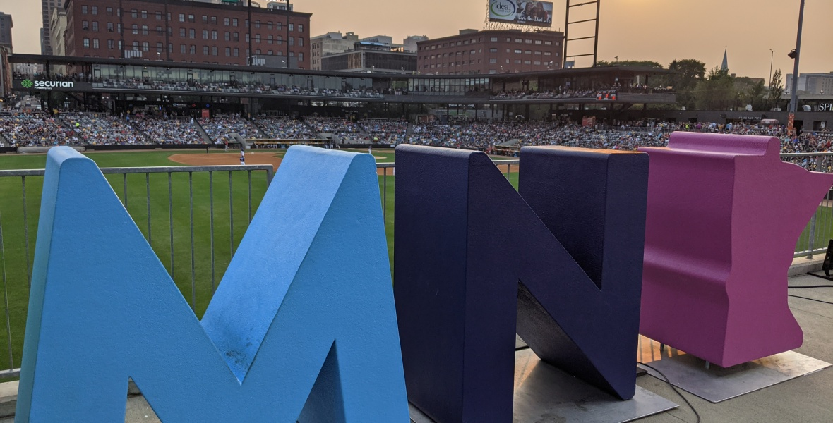MN sculpture letters overlooking CHS baseball field, sunset, St. Paul skyline